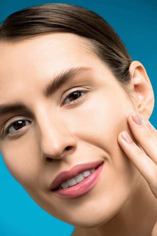 Woman with fresh skin after glycolic acid peel with retinol