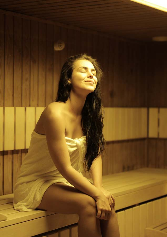 Woman sitting in hot dry sauna KB Day Spa