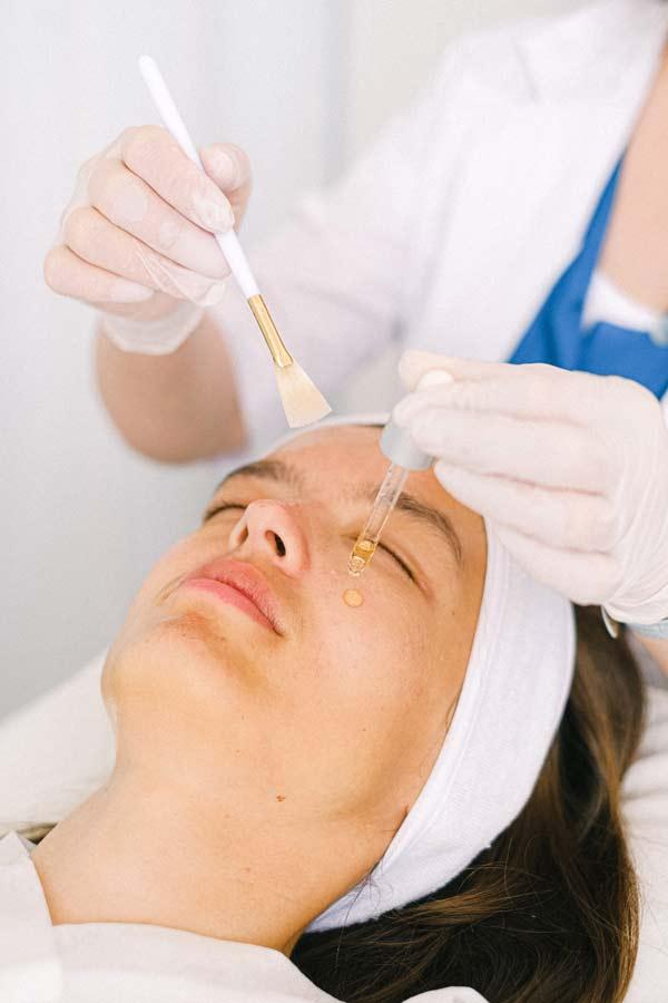 Woman getting a relaxing facial peel