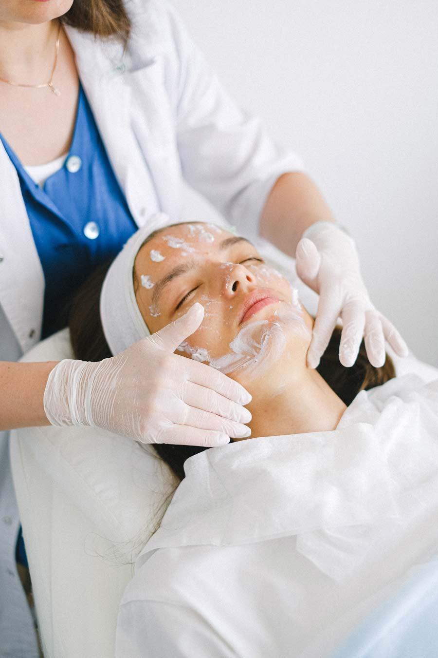 Woman receiving a glycolic acid peel with retinol accelerator